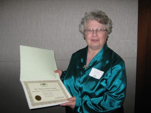 Ruth Berman with award